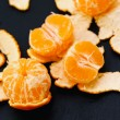 Shelled mandarins on black — Stock Photo #58997201