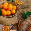 Heap of mandarins with dry oranges and cinnamon — Stock Photo #58997313