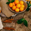 Heap of mandarins with dry oranges and cinnamon — Stock Photo #58997323