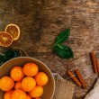 Heap of mandarins with dry oranges and cinnamon — Stock Photo #58997335