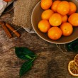 Heap of mandarins with dry oranges and cinnamon — Stock Photo #58997345