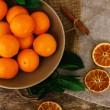 Heap of mandarins with dry oranges and cinnamon — Stock Photo #58997359