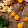 Heap of mandarins with dry oranges and cinnamon — Stock Photo #58997383