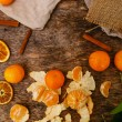 Heap of mandarins with dry oranges and cinnamon — Stock Photo #58997391