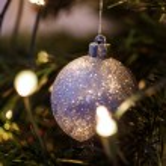 Christmas ball on shiny fur-tree — Stock Photo #58998927