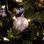 Christmas ball on shiny fur-tree — Stock Photo #58998929
