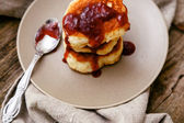 Homemade pancakes on plate with spoon — Stock Photo