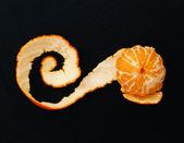 Shelled mandarin on  black — Stock Photo