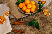 Heap of mandarins with dry oranges and cinnamon — Stock Photo