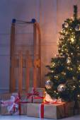 Shiny Christmas tree with gifts — Stock Photo