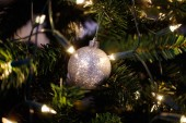 Christmas ball on shiny fur-tree — Stock Photo