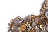 Heap of small gears on a white — Stock Photo
