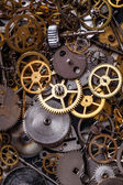 Heap of small gears on the table — Stock Photo