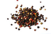 Heap of peppercorn on a white — Stock Photo