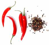 Red chili pepper and heap of peppercorn — Foto de Stock