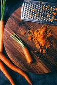 Grated carrots on the table — 图库照片