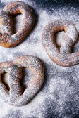 Delicious pretzels on the table — Stock Photo