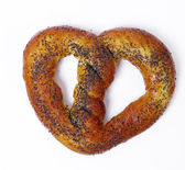 Delicious pretzel on a white — Stock Photo