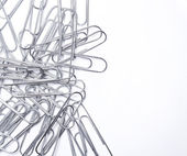 Paper clips on a white — Stock Photo