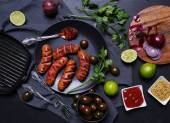 Grilled sausages on the table — Stock Photo