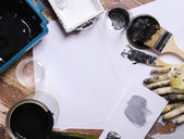 Black paint on the table — Stock Photo