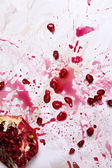 Smashed pomegranate on the table — Stock Photo