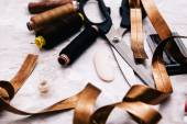 Sewing tools on the marble table — Stock Photo