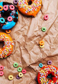 Donuts on a wrinkled paper — Stock Photo