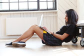 Beautiful girl studying with laptop — Stock Photo