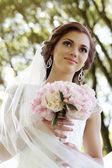 Beautiful bride in park — Stock Photo