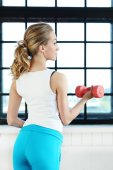 Beautiful woman in the gym — Stock Photo