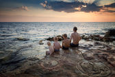 Father with children on the beach — Stock Photo