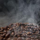 Roasted coffee with smoke — Stock Photo