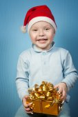 Boy in a cap of Santa Claus with gifts — Stock Photo