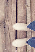 Wellies boots on the wooden path — Stock Photo