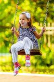 Niña bonita en balancín — Foto de Stock
