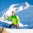 Man climbing exploring winter mountains — Stok fotoğraf #57855223