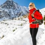 Woman hiker walking in Himalaya Mountains, Nepal — Stock Photo #57855331