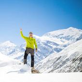 Climbing success in winter snowy mountains — Stock Photo