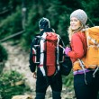 Couple hikers walking in mountains — Stock Photo #58242579