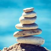 Stones balance, vintage pebbles stack background — Stockfoto