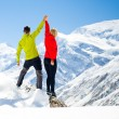 Couple hiking man and woman success in winter mountains — Stock Photo #58434387