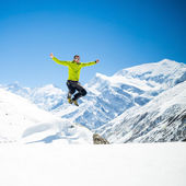 Happy man jumping success in mountains — Stock Photo
