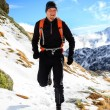 Trail running in mountains on winter beautiful day — Stock Photo #59761549