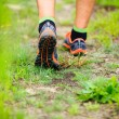 Sports shows running walking on trail — Stock Photo #60299743