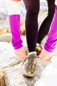 Woman runner tying sport shoe trail running — Foto de Stock