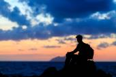 Hiking silhouette backpacker, man trail runner in mountains — Stock Photo