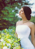 Bride in spring garden — Stock Photo