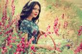 Beautiful woman in spring garden — Stock Photo
