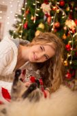 Girl near a new-year tree with a cat — Stock Photo